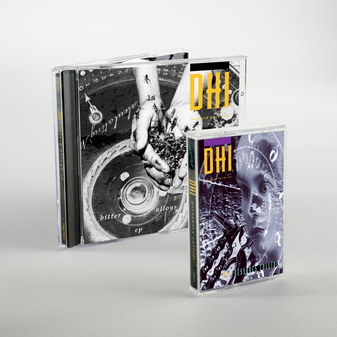 The original Pressures Collide cassette and Bitter Alloys CD packaging, released by DHI (death and horror inc) in 1994 and 1993 respectively.